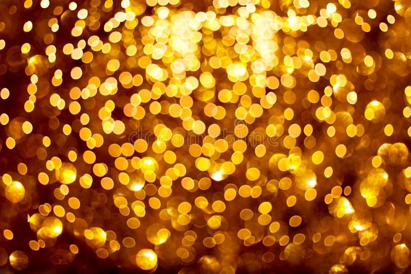 Blurred golden lights on black background. royalty free stock photography
