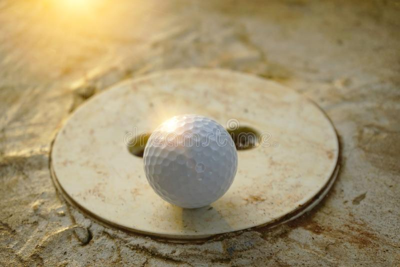 Blurred golf ball is on barrier in golf course stock photo