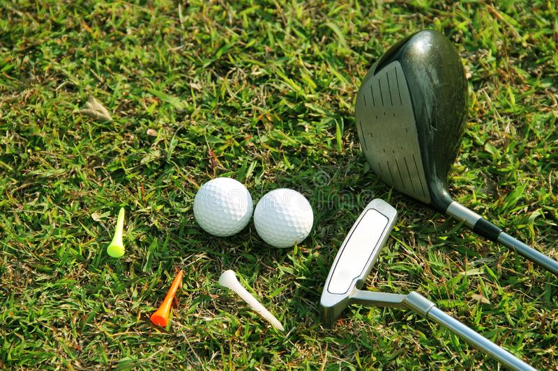 Blurred golf club and golf ball close up in grass field royalty free stock photography