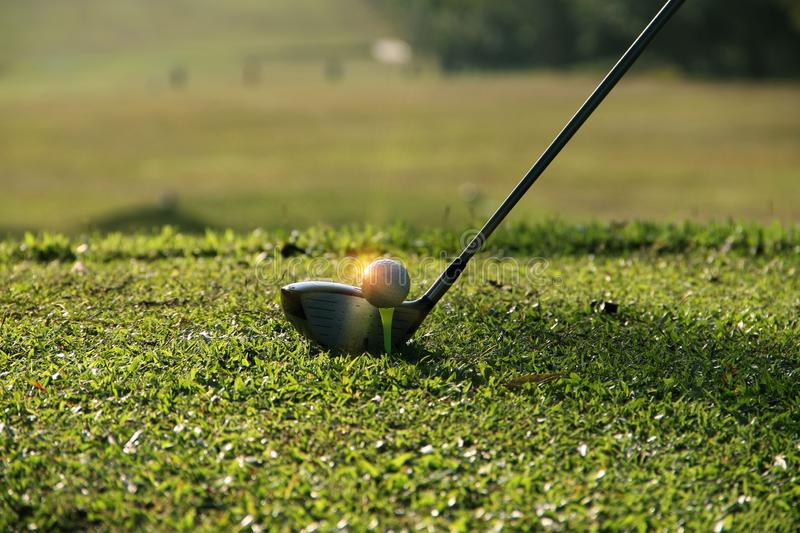 Blurred golf club and golf ball close up in grass field royalty free stock photos