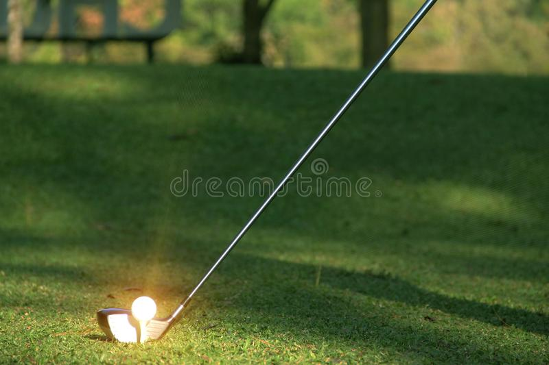 Blurred golf club and golf ball close up in grass field stock images