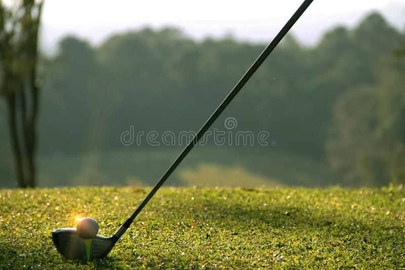 Blurred golf club and golf ball close up in grass field royalty free stock image
