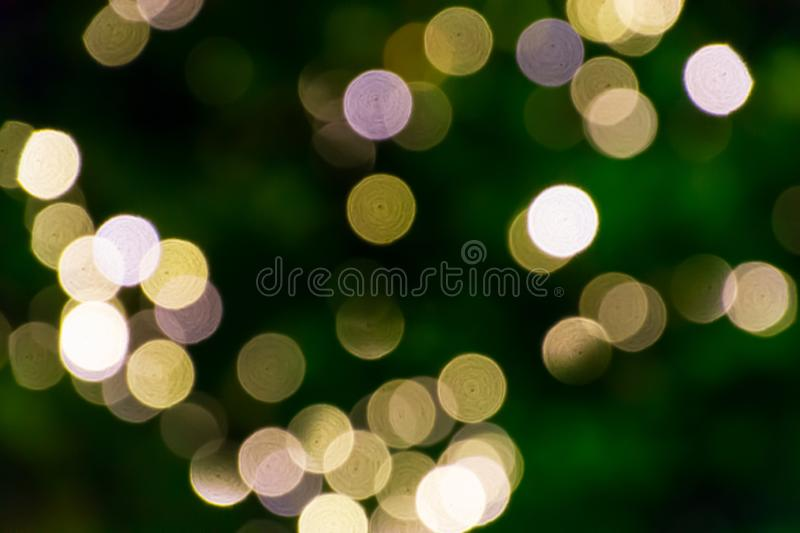 Blurred green fir tree lights background with bokeh.Texture with soft focus. Decoration, design, holiday, abstract, bright, card, celebration, shiny, sparkle stock photo