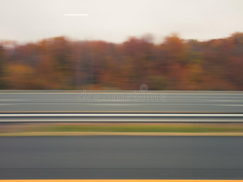 Blurred highway in autumn stock images
