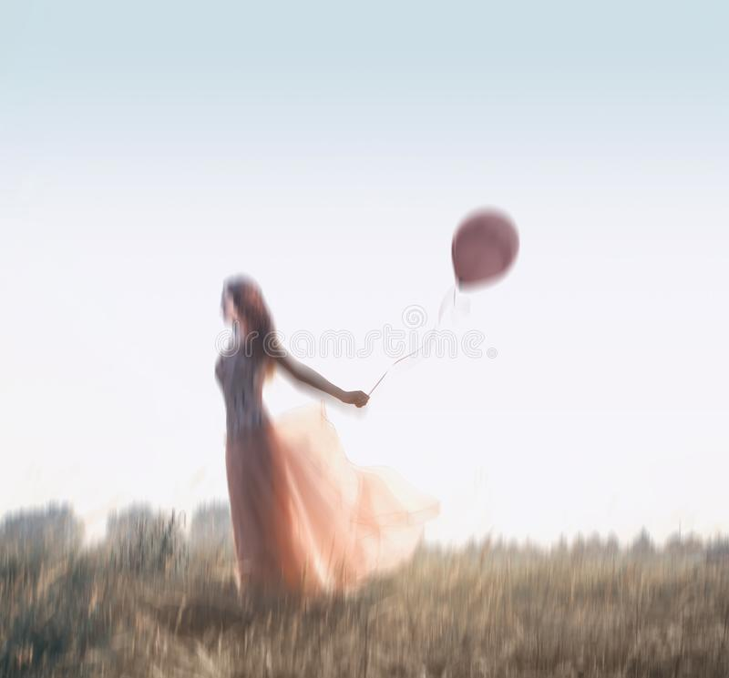 Young girl with a pink balloon. Blurred image of ayoung girl with a pink balloon stock photos