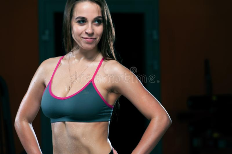 Beautiful sports torso of young woman at the gym stock photo