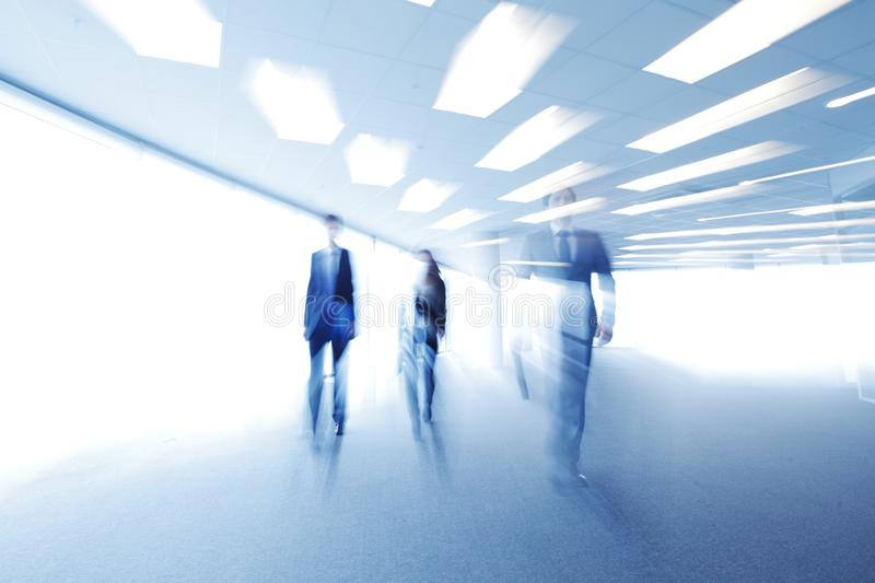 Blurred image of business people walking royalty free stock images