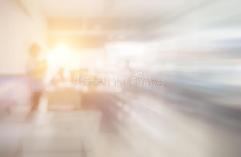 Blurred image of counter service at hotel for background usage. Blur abstract background hall customer or cashier desk indoor space in office bank interior stock image