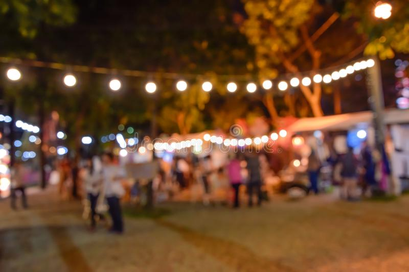 Blurred image  - Defocus of people walking around the night tourism festival in a park in Bangkok, Thailand, people walking around stock images