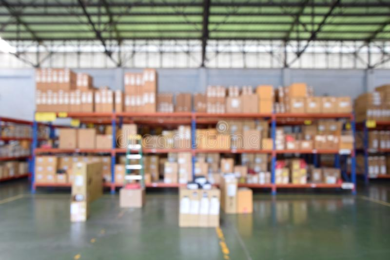 Blurred Image - Defocus of Products in the packaging box arranged on the shelves in the warehouse, The product box placed on the. Floor not a mess, amazon royalty free stock photos