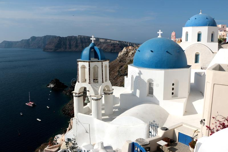Blurred image of the famous 3 Blue Domes at Santorini.  stock photos