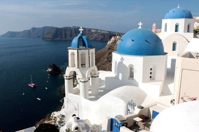 Blurred image of the famous 3 Blue Domes at Santorini.  royalty free stock images