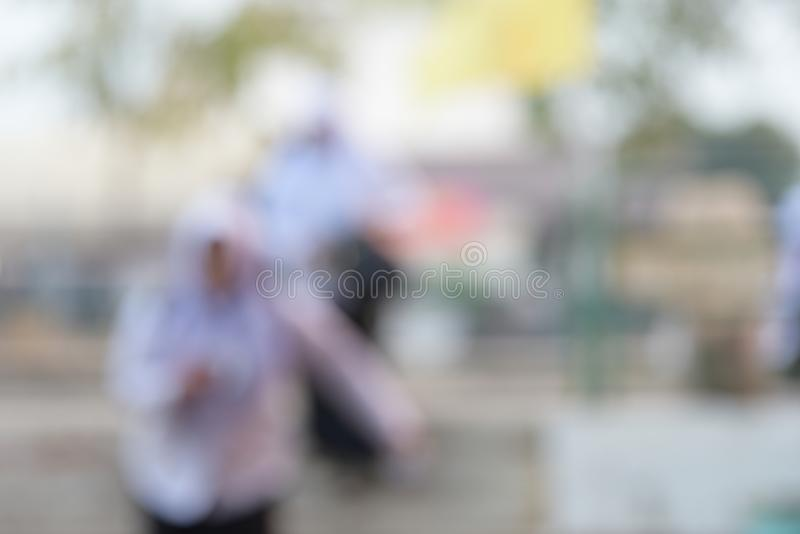 Blurred image, Islamic woman carrying a bag on a train stock image