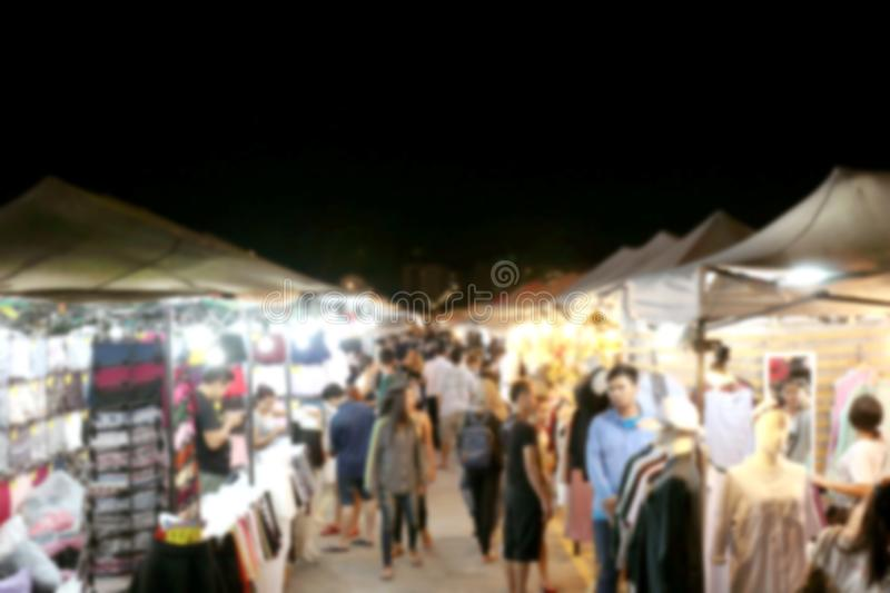 Blurred image a lot of people Shopping at Walking Night Market Thailand on Weekends, Many Person at Night street fashion market stock photo