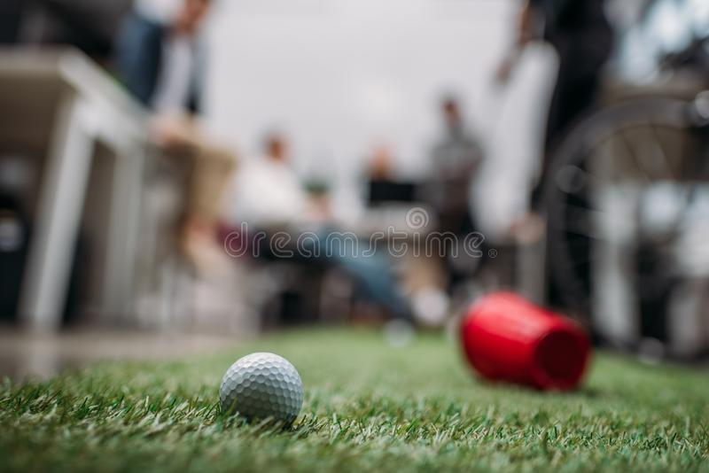 blurred image of people playing in mini golf stock images