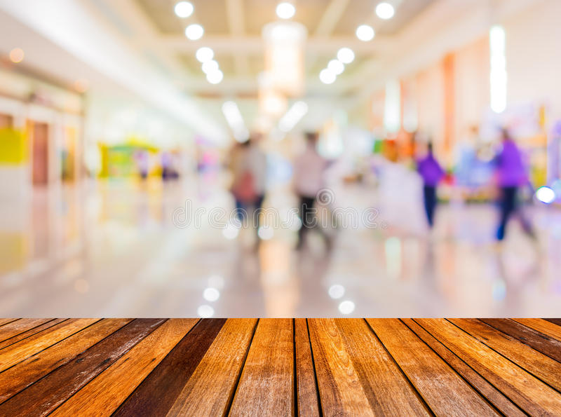 Blurred image of people at trade show. Blurred image of wood table and trade show in shopping mall for background usage royalty free stock photography