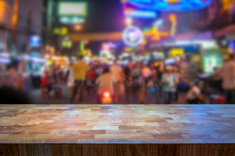 Blurred image of people walking at a busy street with neon signs at night. stock images