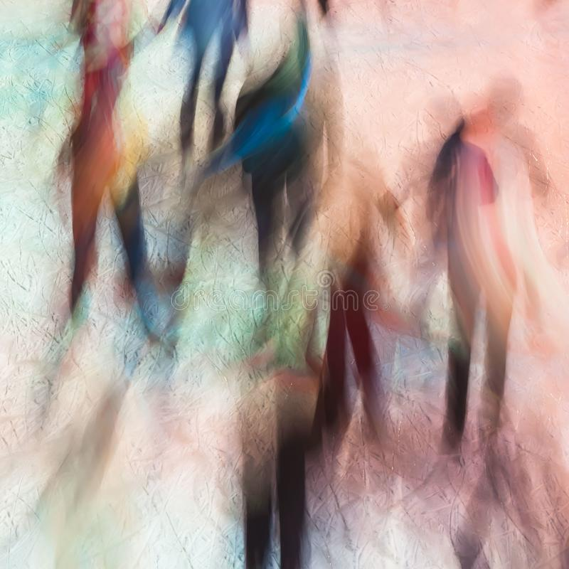 Blurred image of silhouettes of people on skating rink as multi-colored angels. Magic ice. Festive background. Concept stock photography