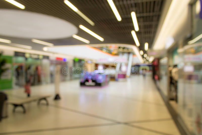 Blurred image of supermarket or lobby of shopping center royalty free stock photo
