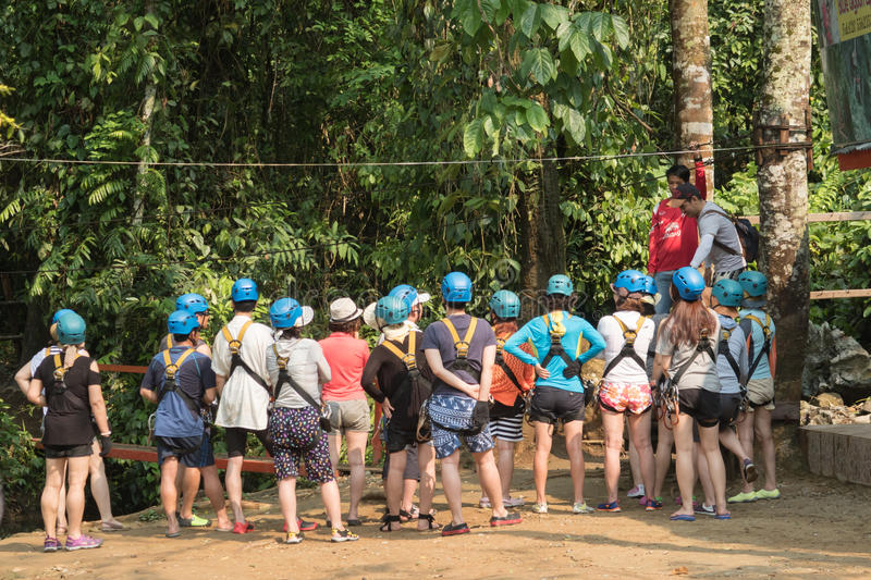 Blurred image of Visitors listen to the Tourist Guide before playing a zip-line. stock photo