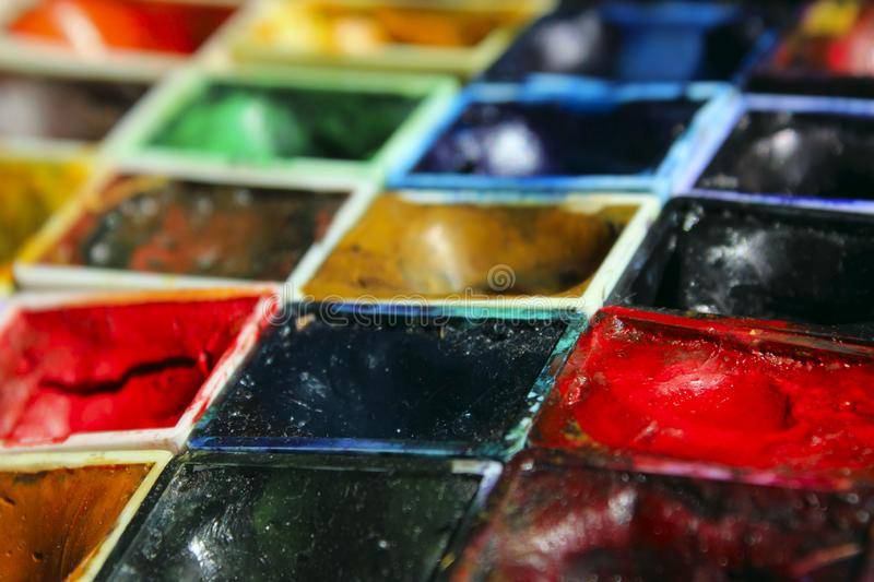 Art materials, hobby concept. Palette of colors, close up. Blurred image of watercolor pallet. Art materials, hobby concept. Palette of colors, close up stock image