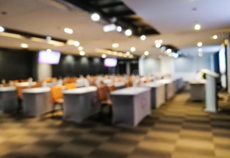 Blurred images of meeting rooms - meeting rooms to set tables and chairs beautifully arranged and ready to accommodate attendees,. The meeting room is royalty free stock images