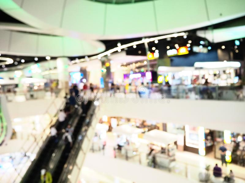 Blurred interior of shopping mall. The modern building concept.  royalty free stock image