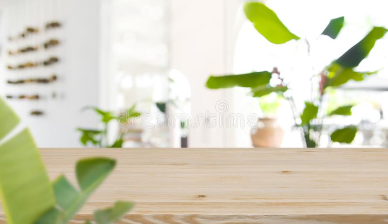 Blurred interior of tropical resort in front of wooden tabletop stock photography