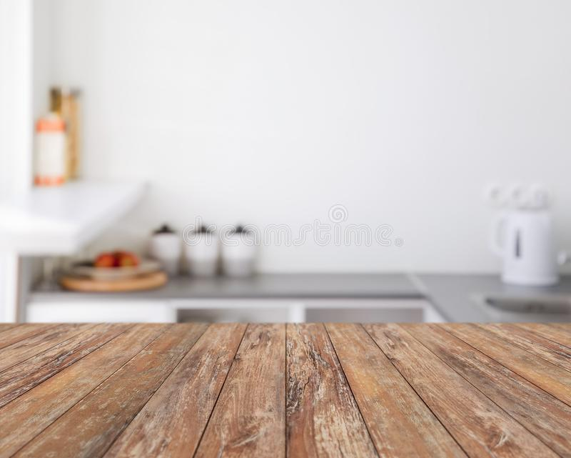Blurred kitchen background with wooden boards stock photo