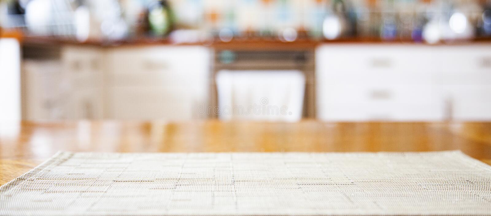 blurred kitchen interior with napkin on table stock photos