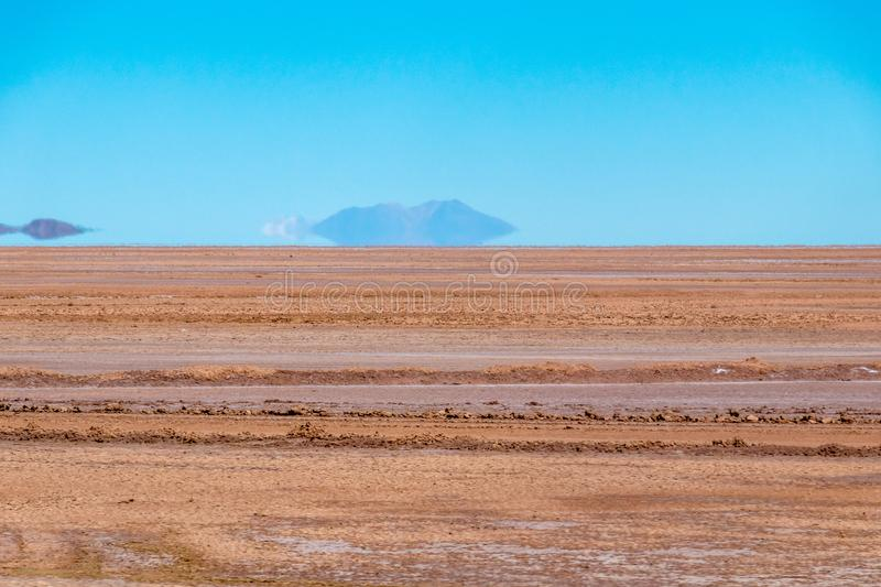 Blurred landscape of Bolivian desert in sunny day with blue sky Eduardo Avaroa Park, Bolivia. Blurred bright landscape of roadside in desert of the Eduardo stock photos