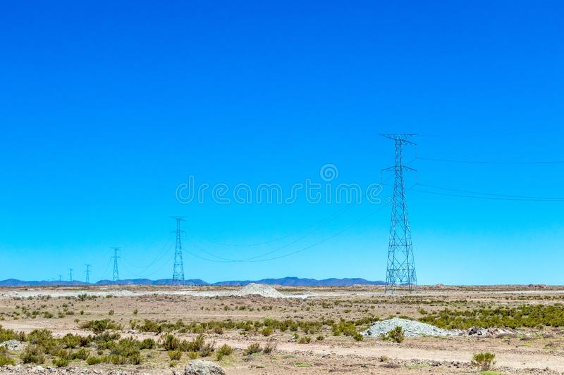 Blurred landscape of Bolivian desert in sunny day with blue sky Eduardo Avaroa Park, Bolivia. Blurred bright landscape of roadside in desert of the Eduardo stock photo