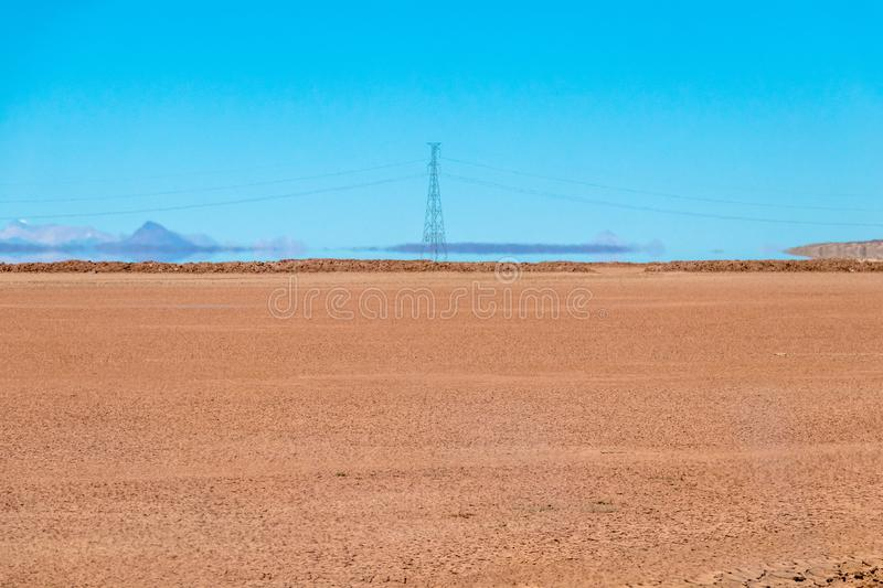 Blurred landscape of Bolivian desert in sunny day with blue sky Eduardo Avaroa Park, Bolivia. Blurred bright landscape of roadside in desert of the Eduardo royalty free stock images