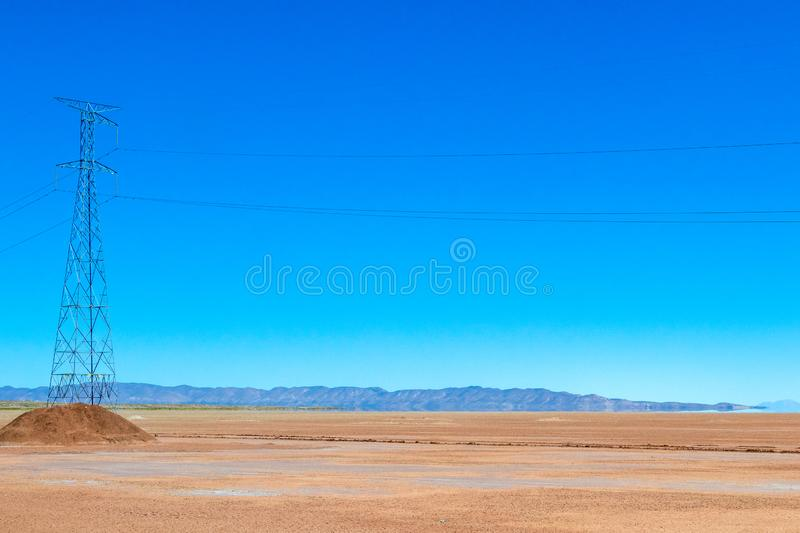 Blurred landscape of Bolivian desert in sunny day with blue sky Eduardo Avaroa Park, Bolivia. Blurred bright landscape of roadside in desert of the Eduardo royalty free stock photo