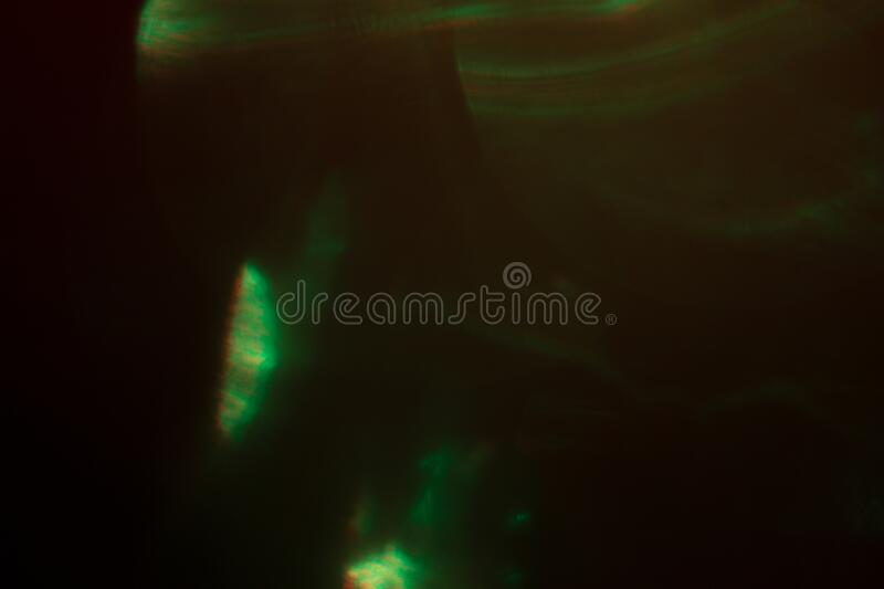 Blurred lens flare. Defocused colorful lights. Shiny glowing spots, abstract background and texture stock photos