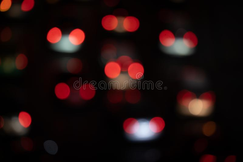 Blurred Light night at city blue bokeh abstract black background blur lens flare reflection beautiful circle glitter merry stock photography