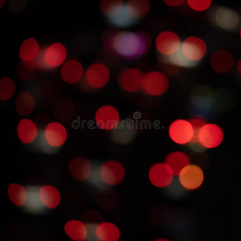 Blurred Light night at city blue bokeh abstract black background blur lens flare reflection beautiful circle glitter merry royalty free stock photos