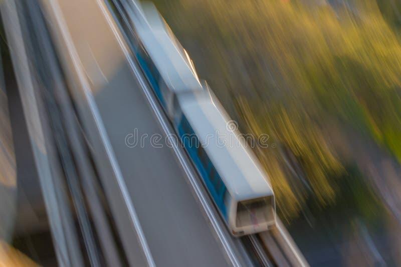 Blurred Light Rail Train Cars. Elevated light rail train speeding to its destination stock images