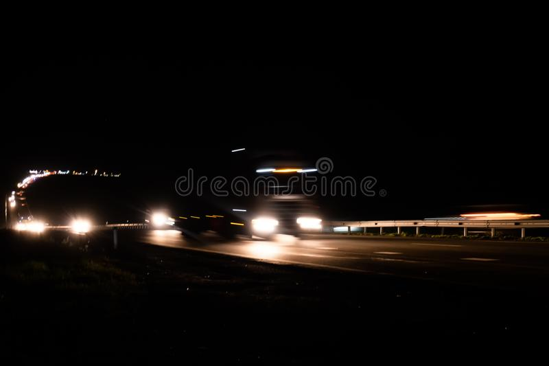 Blurred lights with car on high speed..A car driving on a motorway at high speeds, overtaking other cars.  stock photography
