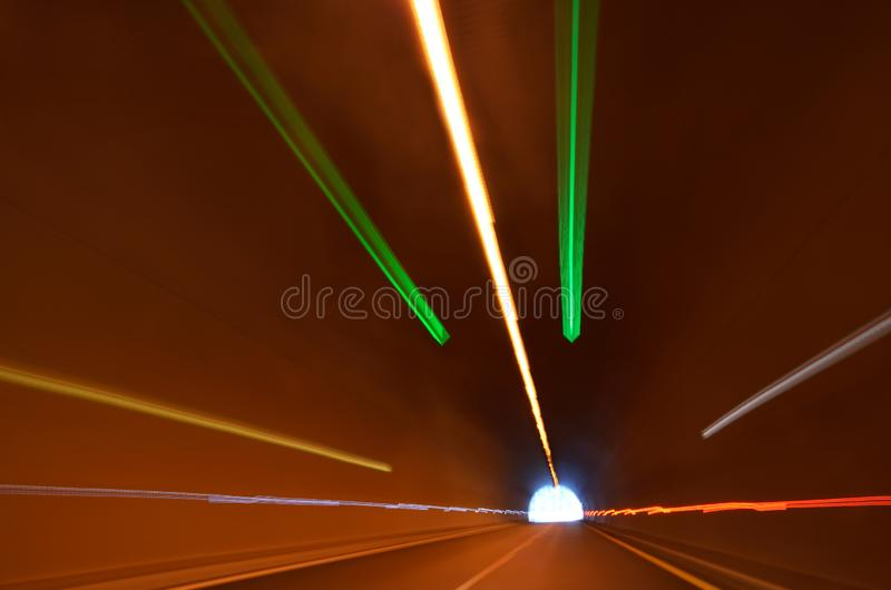 Blurred lights in tunnel stock photo
