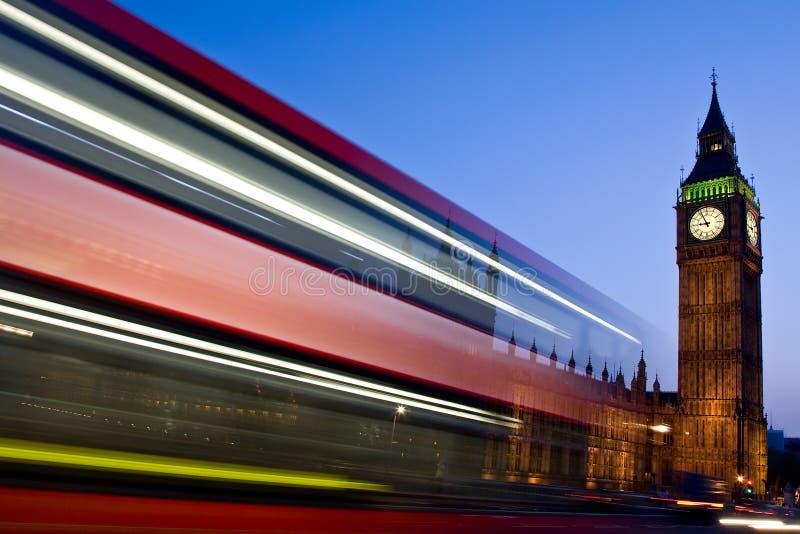 Blurred London double-decker bus passes Big Ben royalty free stock photo