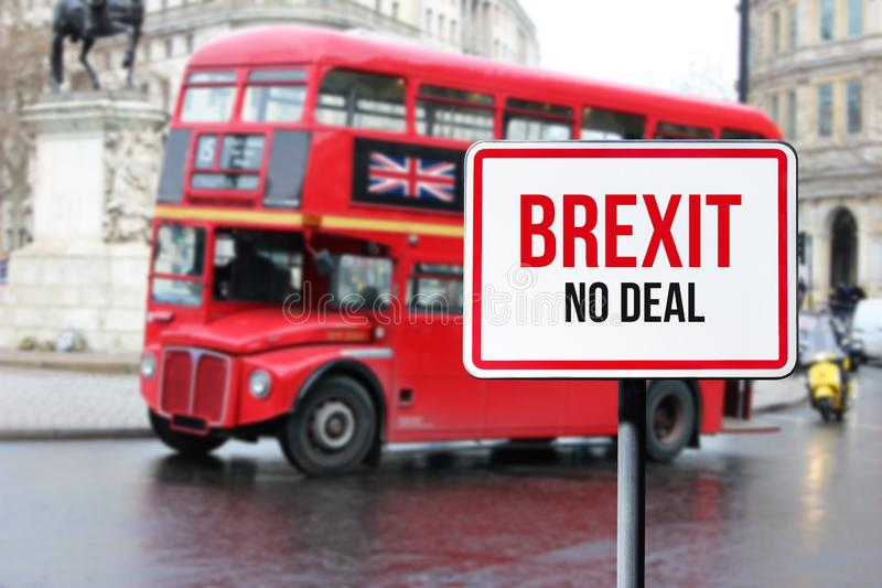 Blurred London street view with red double decker bus and Brexit no deal sign in rainy day. Possible exit of Great royalty free stock photo