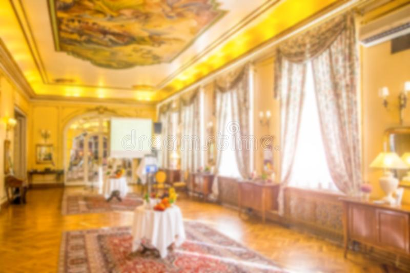 Blurred meeting hall in old luxurious style prepared for event.  royalty free stock photography