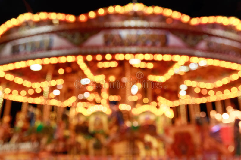 Blurred merry-go-round in Winter Wonderland. For background use stock image