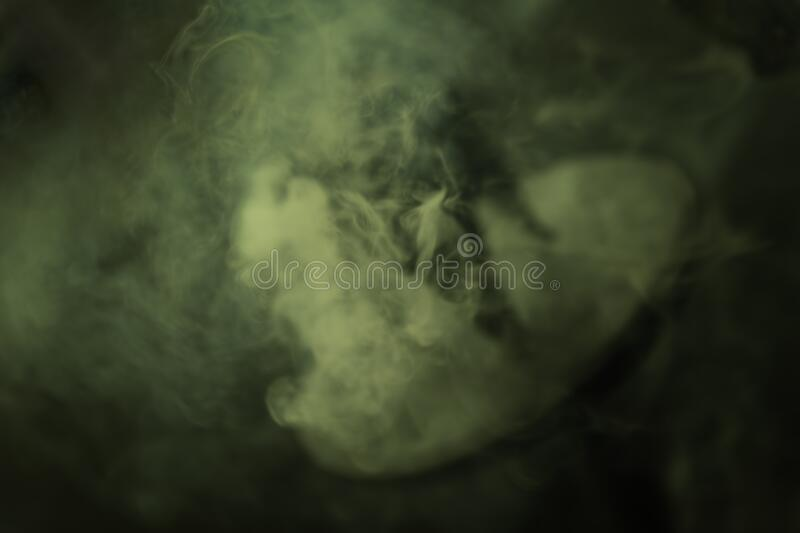 Blurred, mint green, wisp of smoke from burning incense royalty free stock photography