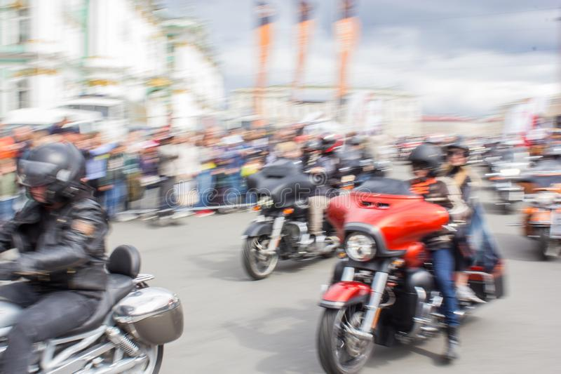 Blurred motion of a biker column royalty free stock photo