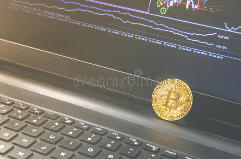 Bitcoin coin placed on black notebook . Close-Up Bitcoin , exchange virtual value, crypto digital money . Background Live Stock royalty free stock photos