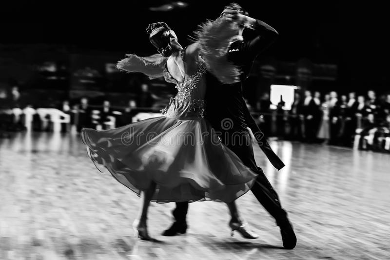 Blurred motion couple of dancers stock images
