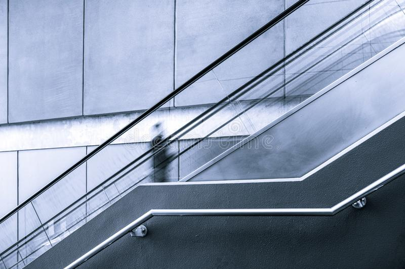 Blurred motion of one person on escalator. stock photo