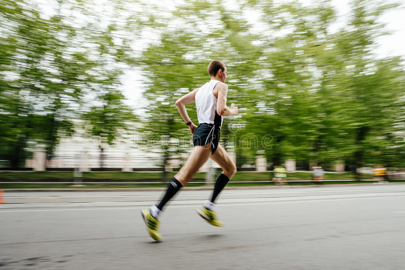 Blurred motion runner man running on city street royalty free stock photography